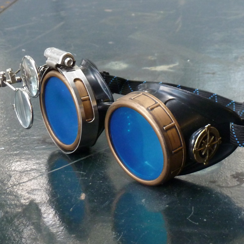 black and bronze steampunk goggles with blue lenses eye loupe