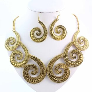gold/brass tone statement necklace with chunky earrings