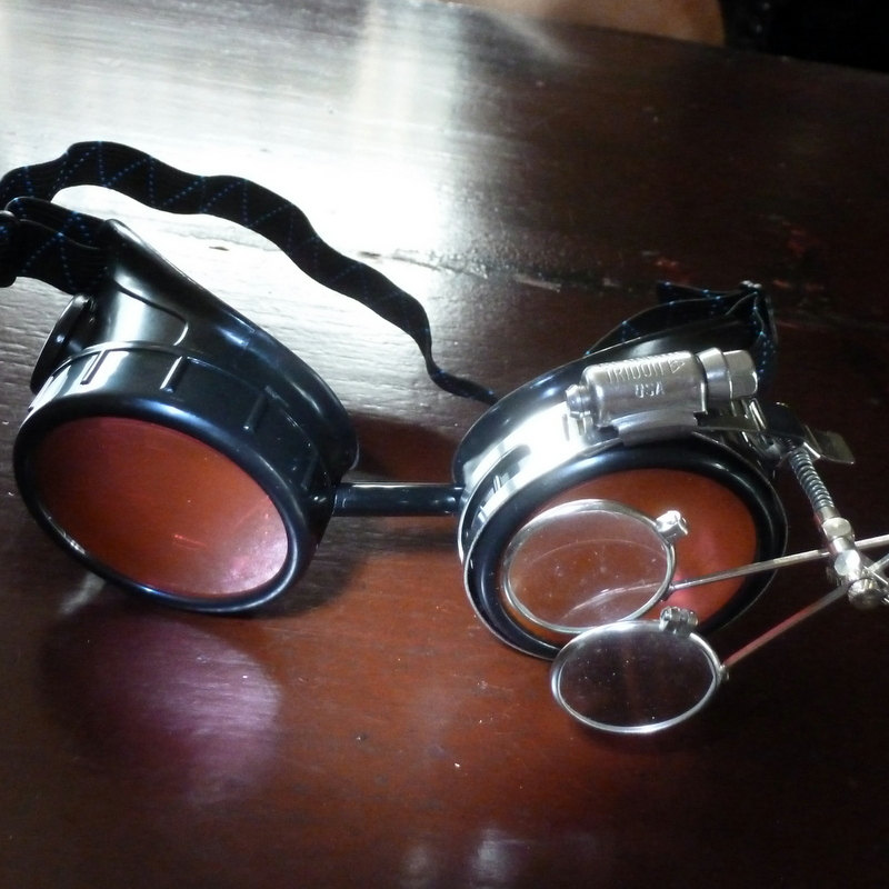 Black Goggles: Red Lenes w/ Brass Watch Movement & Eye Loupe