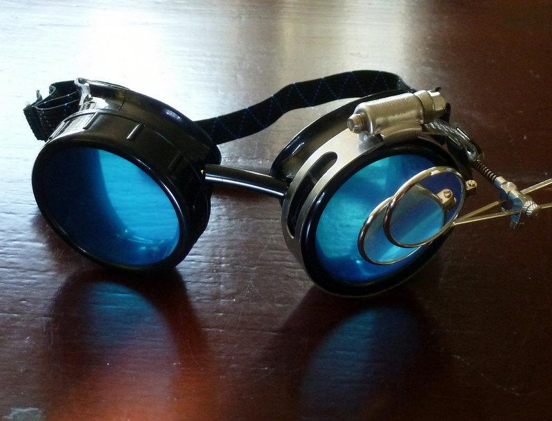 Black Goggles: Blue Lenses w/ Eye Loupe & Swirl Embellishments