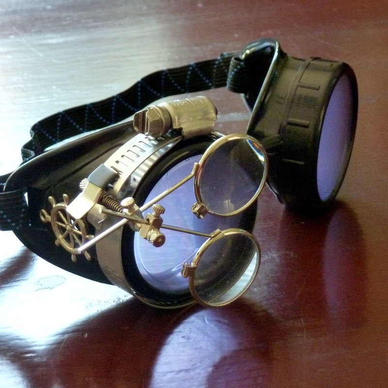 Black Goggles: Light Purple Lenses w/ Brass Ship's Wheel & Eye Loupe