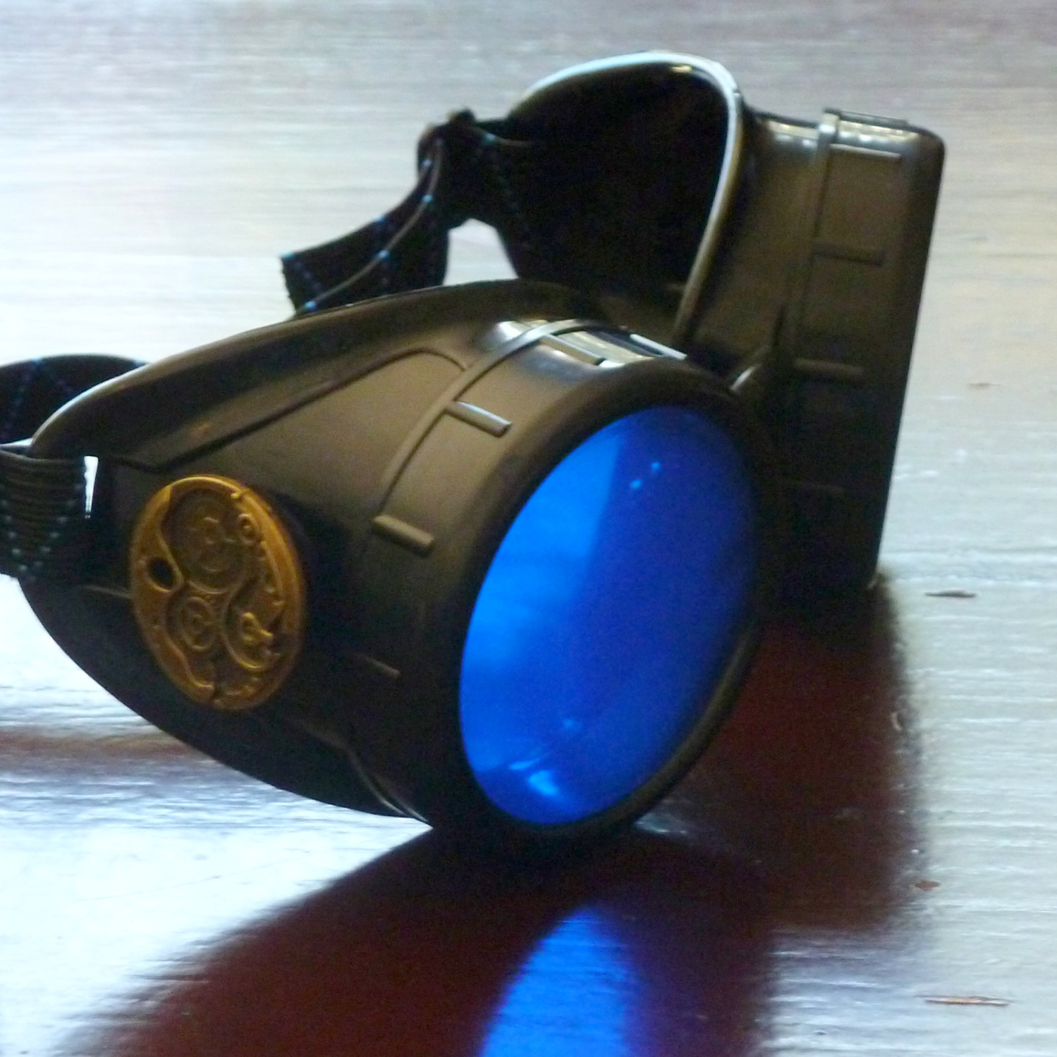 Black Goggles: Blue Lenses w/ Brass Watch Movement