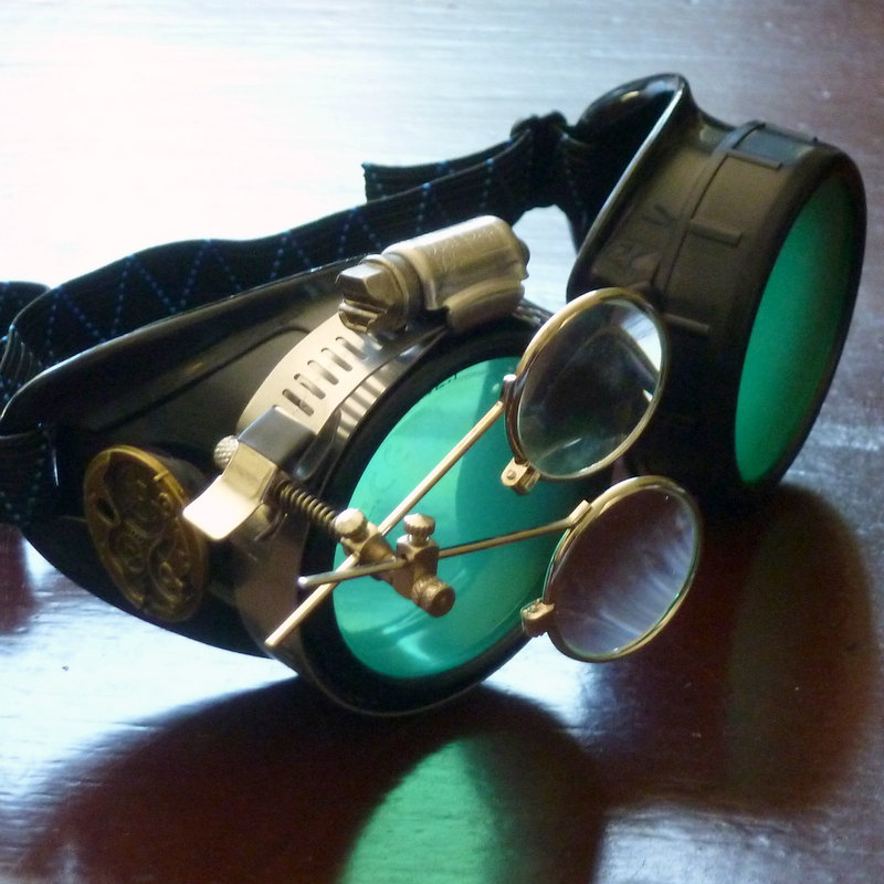 Black Goggles: Green Lenses w/ Eye Loupe & Brass Watch Movement