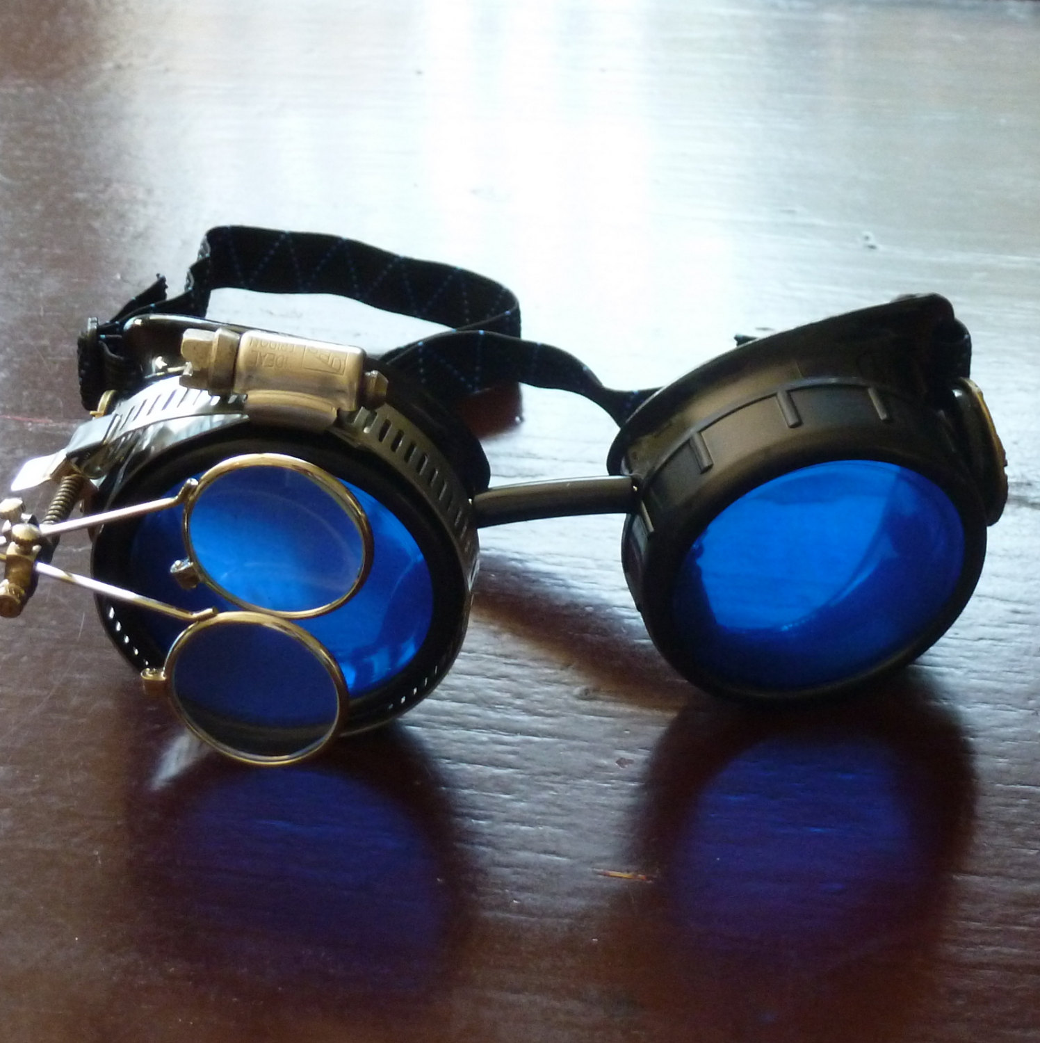 Black Goggles: Blue Lenses w/ Brass Watch Movement & Eye Loupe