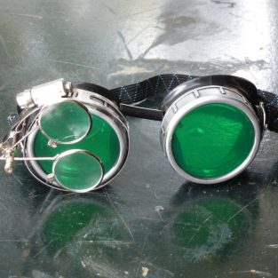 Sliver & Black Goggles: Green Lenses w/ Nickel Compass Rose & Eye Loupe
