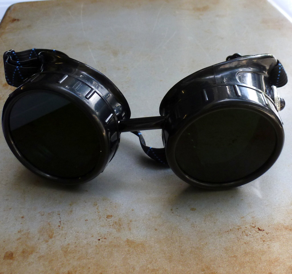 Black Goggles: Dark Lenses & Black Turquoise Side Pieces