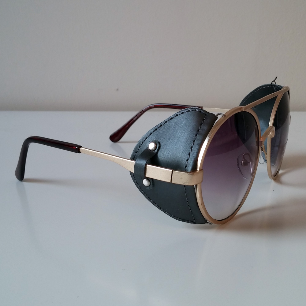 purple amp gold toned sunglasses with fabric windguard