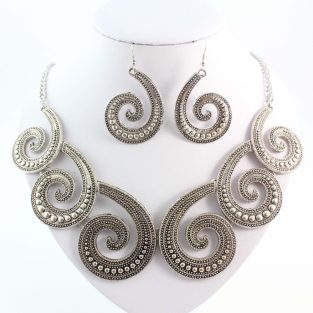 Silver tone statement necklace with chunky earrings